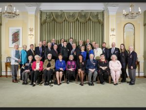 Back row, fourth from the right, Graham Robertson stands with the rest of the local islanders who were recently honoured with the Sovereigns Medal for Volunteer Service.